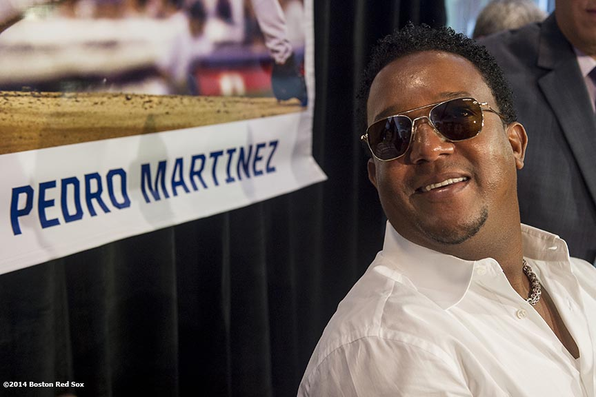 """Former pitcher and Boston Red Sox Class of 2014 Hall of Fame inductee Pedro Martinez meets with media during the 2014 Hall of Fame luncheon at Fenway Park in Boston, Massachusetts Thursday, August 14, 2014."""