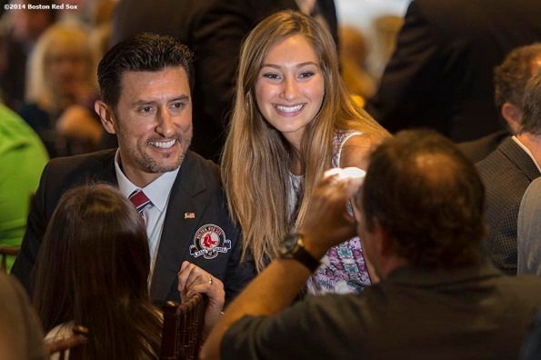 """""""Boston Red Sox Class of 2014 Hall of Fame inductees Nomar Garciaparra poses for a photograph with a fan during the 2014 Hall of Fame luncheon at Fenway Park in Boston, Massachusetts Thursday, August 14, 2014."""""""