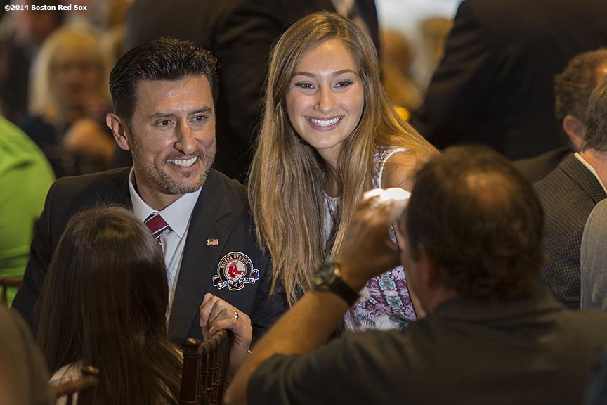 """Boston Red Sox Class of 2014 Hall of Fame inductees Nomar Garciaparra poses for a photograph with a fan during the 2014 Hall of Fame luncheon at Fenway Park in Boston, Massachusetts Thursday, August 14, 2014."""