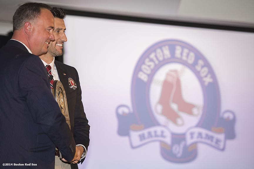 """Former shortstop Nomar Garciaparra is presented with a plaque by NESN broadcaster Don Orsillo as he is inducted as a member of the Boston Red Sox Hall of Fame during the 2014 Hall of Fame luncheon at Fenway Park in Boston, Massachusetts Thursday, August 14, 2014."""