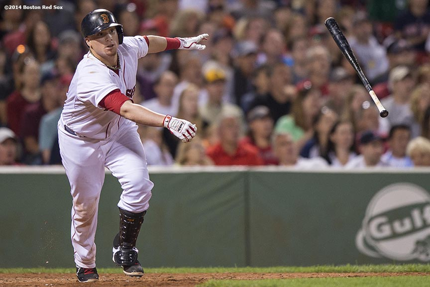 """Boston Red Sox catcher Christian Vazquez hits a sacrifice fly during the sixth inning of a game against the Houston Astros at Fenway Park in Boston, Massachusetts Thursday, August 14, 2014."""
