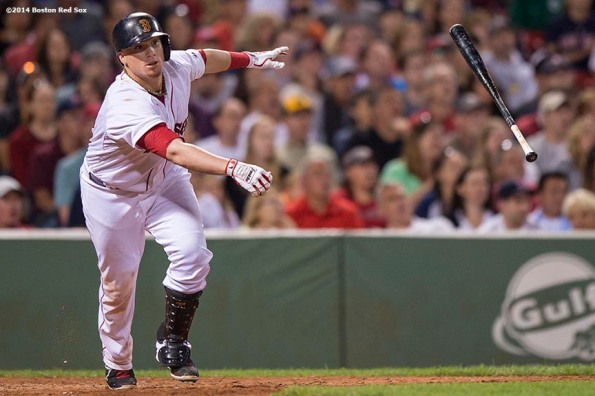 """""""Boston Red Sox catcher Christian Vazquez hits a sacrifice fly during the sixth inning of a game against the Houston Astros at Fenway Park in Boston, Massachusetts Thursday, August 14, 2014."""""""