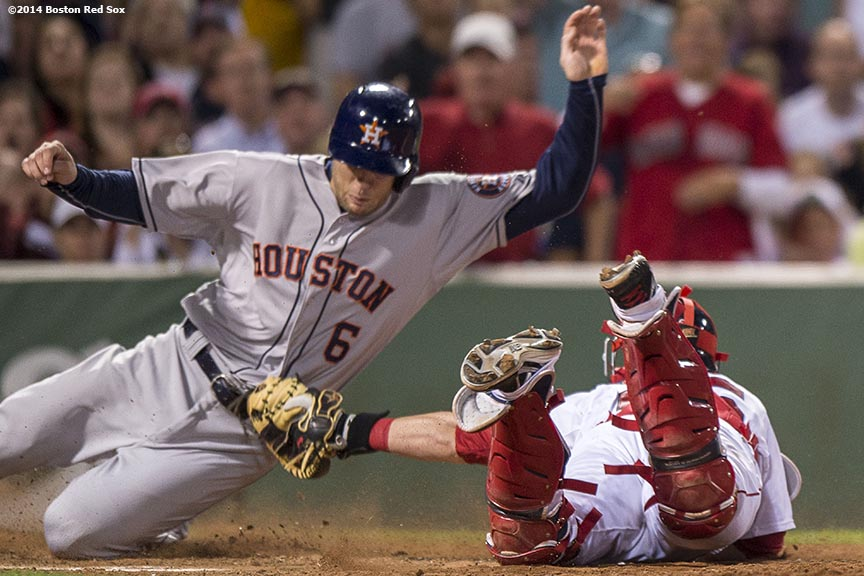 """Boston Red Sox catcher Christian Vazquez makes a play at the plate during the seventh inning of a game against the Houston Astros at Fenway Park in Boston, Massachusetts Thursday, August 14, 2014."""