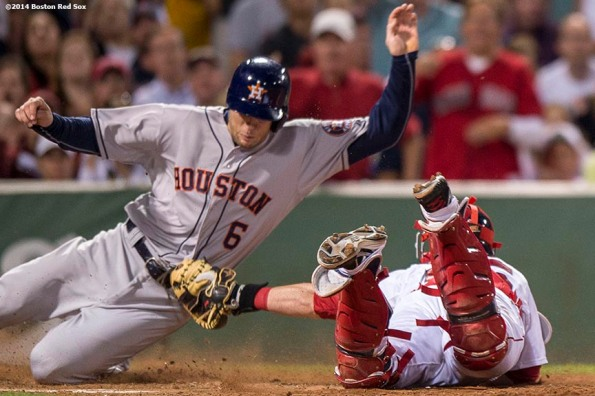 """""""Boston Red Sox catcher Christian Vazquez makes a play at the plate during the seventh inning of a game against the Houston Astros at Fenway Park in Boston, Massachusetts Thursday, August 14, 2014."""""""