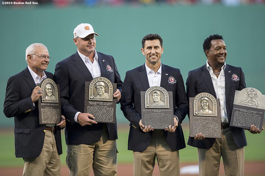 """Boston Red Sox Class of 2014 Hall of Fame inductees Joe Castiglione, Roger Clemens, Nomar Garciaparra, and Pedro Martinez are presented with plaques during a special pre-game ceremony before a game against the Houston Astros at Fenway Park in Boston, Massachusetts Thursday, August 14, 2014."""