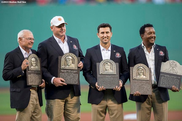 """""""Boston Red Sox Class of 2014 Hall of Fame inductees Joe Castiglione, Roger Clemens, Nomar Garciaparra, and Pedro Martinez are presented with plaques during a special pre-game ceremony before a game against the Houston Astros at Fenway Park in Boston, Massachusetts Thursday, August 14, 2014."""""""