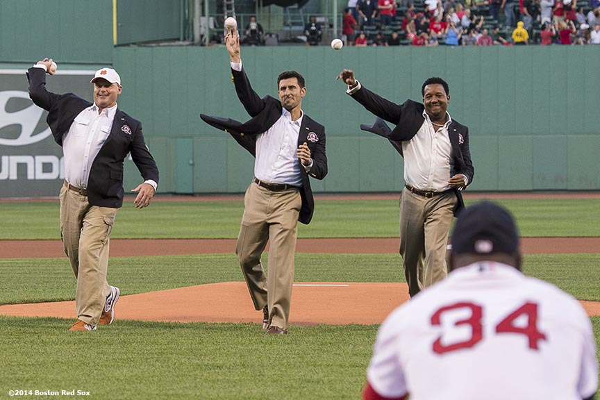 """Boston Red Sox Class of 2014 Hall of Fame inductees Joe Castiglione, Roger Clemens, Nomar Garciaparra, and Pedro Martinez throw out a ceremonial first pitch during a special pre-game ceremony before a game against the Houston Astros at Fenway Park in Boston, Massachusetts Thursday, August 14, 2014."""
