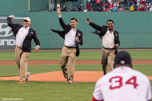 """""""Boston Red Sox Class of 2014 Hall of Fame inductees Joe Castiglione, Roger Clemens, Nomar Garciaparra, and Pedro Martinez throw out a ceremonial first pitch during a special pre-game ceremony before a game against the Houston Astros at Fenway Park in Boston, Massachusetts Thursday, August 14, 2014."""""""
