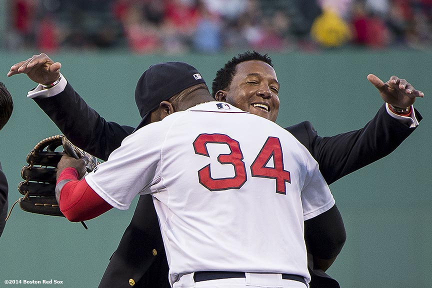 """Boston Red Sox Class of 2014 Hall of Fame inductee Pedro Martinez hugs designated hitter David Ortiz during a special pre-game ceremony before a game against the Houston Astros at Fenway Park in Boston, Massachusetts Thursday, August 14, 2014."""
