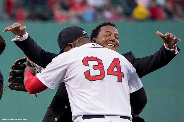 """""""Boston Red Sox Class of 2014 Hall of Fame inductee Pedro Martinez hugs designated hitter David Ortiz during a special pre-game ceremony before a game against the Houston Astros at Fenway Park in Boston, Massachusetts Thursday, August 14, 2014."""""""
