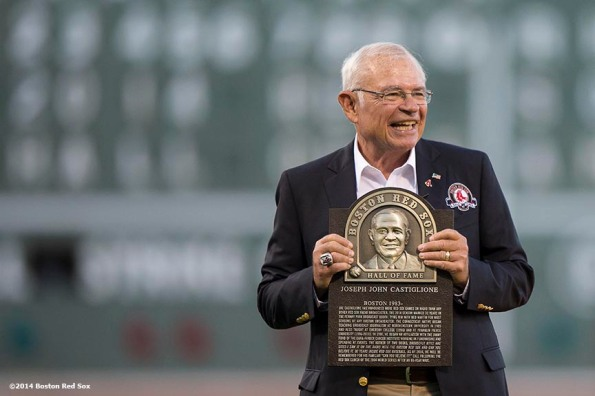 """""""Boston Red Sox Class of 2014 Hall of Fame inductee Joe Castiglione is presented with a plaque during a special pre-game ceremony before a game against the Houston Astros at Fenway Park in Boston, Massachusetts Thursday, August 14, 2014.'"""
