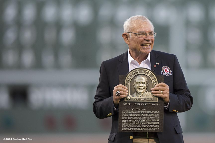 """Boston Red Sox Class of 2014 Hall of Fame inductee Joe Castiglione is presented with a plaque during a special pre-game ceremony before a game against the Houston Astros at Fenway Park in Boston, Massachusetts Thursday, August 14, 2014.'"