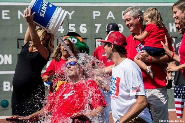 """""""Former Boston College Baseball player Pete Frates, who lives with ALS, accepts the Ice Bucket Challenge to raise awareness for ALS alongside family members and Boston Red Sox manager John Farrell, third baseman Will Middlebrooks, second baseman Dustin Pedroia, and catcher David Ross at Fenway Park in Boston, Massachusetts Thursday, August 14, 2014."""""""