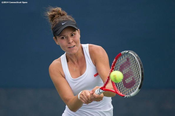 """""""Denise Muresan hits a backhand during US Open National Playoff match against Kelly Chen during the 2014 Connecticut Open at the Yale University Tennis Center in New Haven, Connecticut Friday, August 15, 2014."""""""