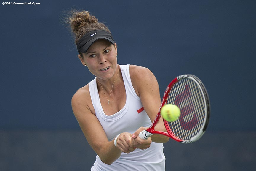 """Denise Muresan hits a backhand during US Open National Playoff match against Kelly Chen during the 2014 Connecticut Open at the Yale University Tennis Center in New Haven, Connecticut Friday, August 15, 2014."""