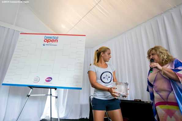 """""""Dominika Cibulkova participates in the draw ceremony at the 2014 Connecticut Open at the Yale University Tennis Center in New Haven, Connecticut Friday, August 15, 2014."""""""