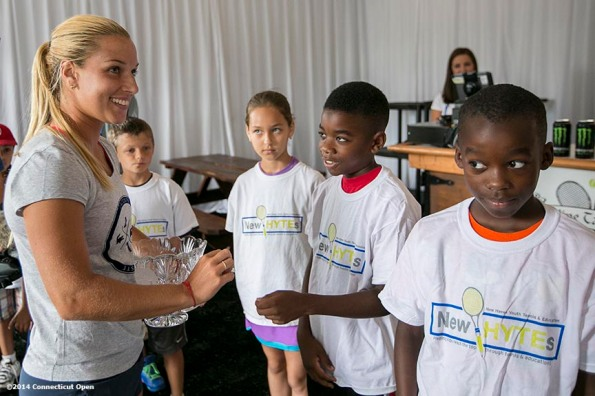 """""""Kids from the New HYTEs youth development organization draw chips from Dominika Cibulkova during the draw ceremony at the 2014 Connecticut Open at the Yale University Tennis Center in New Haven, Connecticut Friday, August 15, 2014."""""""