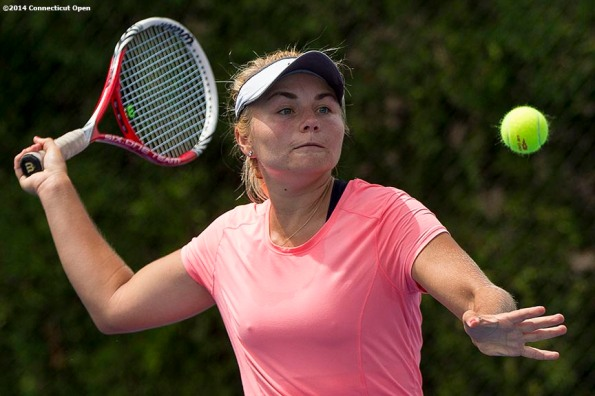 """""""Petra Januskova hits a forehand during a US Open National Playoffs match against Ashley Weinhold during the 2014 Connecticut Open at the Yale University Tennis Center in New Haven, Connecticut Friday, August 15, 2014."""""""