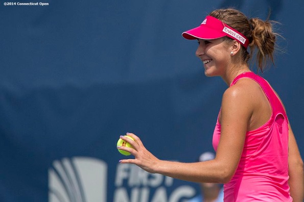 """""""Belinda Bencic smiles during a qualifying round match against An-Sophie Mestach during the 2014 Connecticut Open at the Yale University Tennis Center in New Haven, Connecticut Saturday, August 16, 2014."""""""
