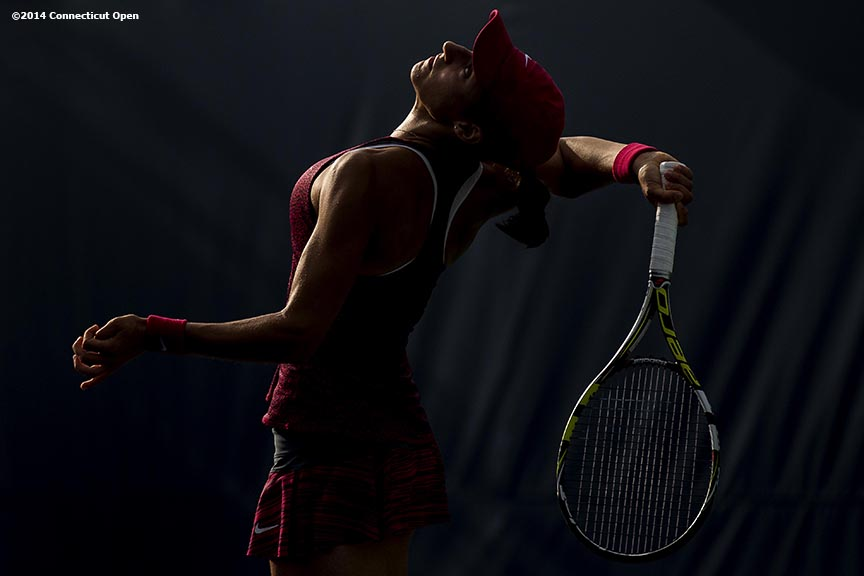 """Caroline Garcia serves during a qualifying round match against Su-Wei Hsieh during the 2014 Connecticut Open at the Yale University Tennis Center in New Haven, Connecticut Saturday, August 16, 2014."""
