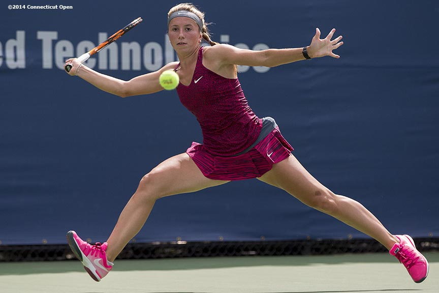 """Annika Beck hits a forehand during a match against Misaki Doi on day three of the 2014 Connecticut Open at the Yale University Tennis Center in New Haven, Connecticut Sunday, August 17, 2014."""