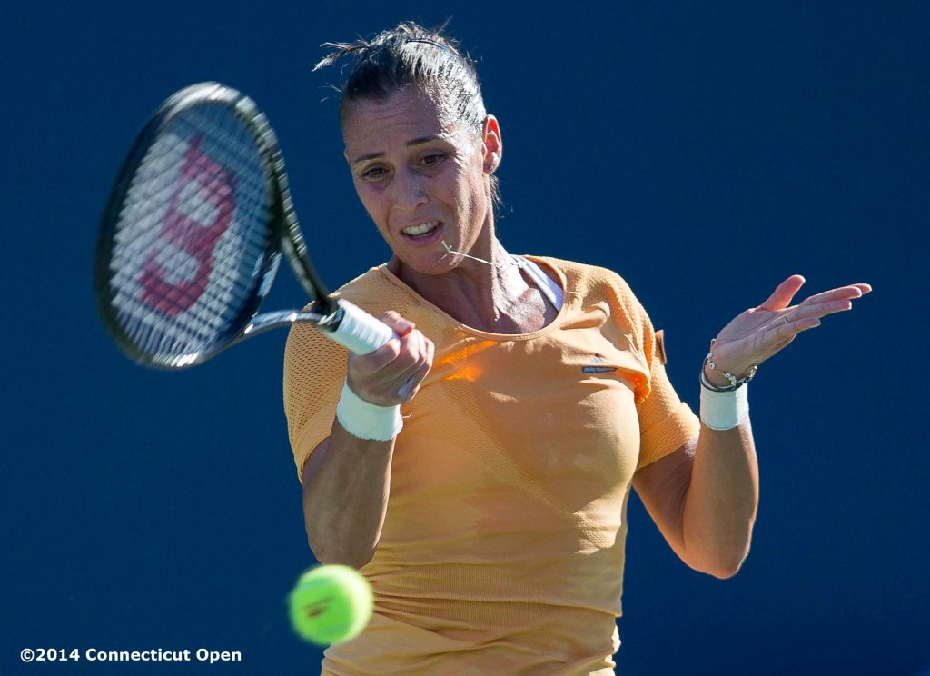 """Flavia Pennetta hits a forehand during a match against Klara Koukalova on day three of the 2014 Connecticut Open at the Yale University Tennis Center in New Haven, Connecticut Sunday, August 17, 2014."""
