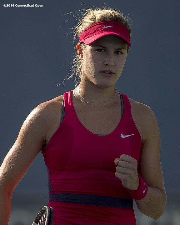 """""""Eugenie Bouchard reacts during during a match against Bojana Jovanovski on day four of the 2014 Connecticut Open at the Yale University Tennis Center in New Haven, Connecticut Monday, August 18, 2014."""""""