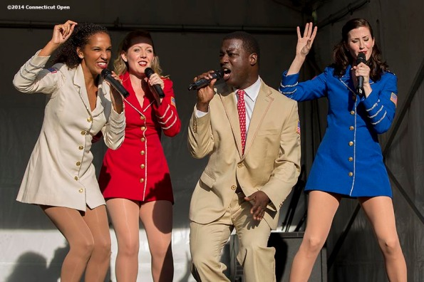 """""""The USO Show Troupe performs during Military Night on day four of the 2014 Connecticut Open at the Yale University Tennis Center in New Haven, Connecticut Monday, August 18, 2014."""""""