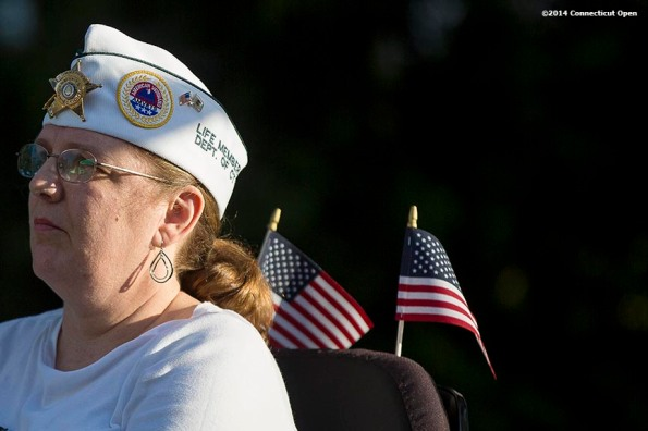 """""""A guest attends Military Night on day four of the 2014 Connecticut Open at the Yale University Tennis Center in New Haven, Connecticut Monday, August 18, 2014."""""""