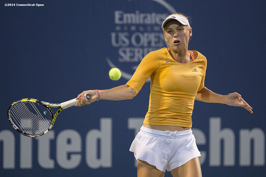 """Caroline Wozniacki hits a forehand during a match against Timea Bacsinszky on day four of the 2014 Connecticut Open at the Yale University Tennis Center in New Haven, Connecticut Monday, August 18, 2014."""