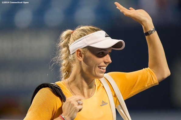"""Caroline Wozniacki waves to fans after a match against Timea Bacsinszky on day four of the 2014 Connecticut Open at the Yale University Tennis Center in New Haven, Connecticut Monday, August 18, 2014."""