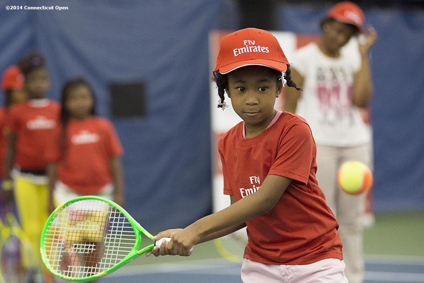 """A boy hits a forehand during the Emirates Airline tennis clinic on day five of the 2014 Connecticut Open at the Yale University Tennis Center in New Haven, Connecticut Tuesday, August 19, 2014."""