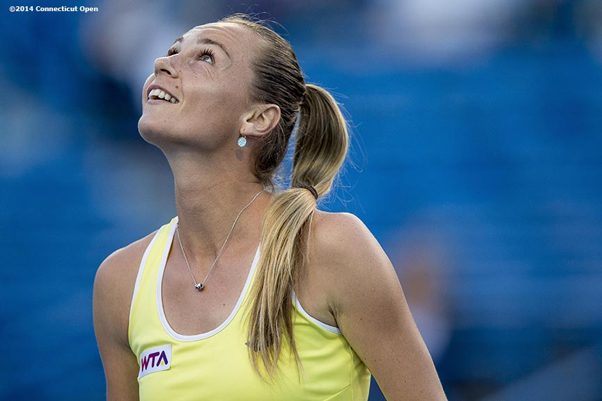 """Magdalena Rybarikova reacts during a match against Simona Halep on day five of the 2014 Connecticut Open at the Yale University Tennis Center in New Haven, Connecticut Tuesday, August 19, 2014."""