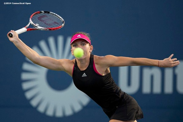 """""""Simona Halep hits a forehand during a match against Magdalena Rybarikova on day five of the 2014 Connecticut Open at the Yale University Tennis Center in New Haven, Connecticut Tuesday, August 19, 2014."""""""