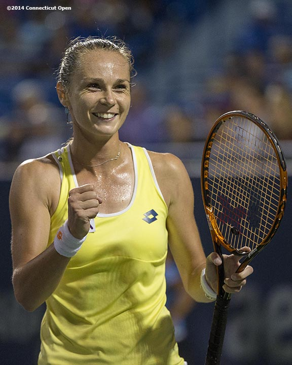 """Magdalena Rybarikova reacts after defeating Simona Halep on day five of the 2014 Connecticut Open at the Yale University Tennis Center in New Haven, Connecticut Tuesday, August 19, 2014."""