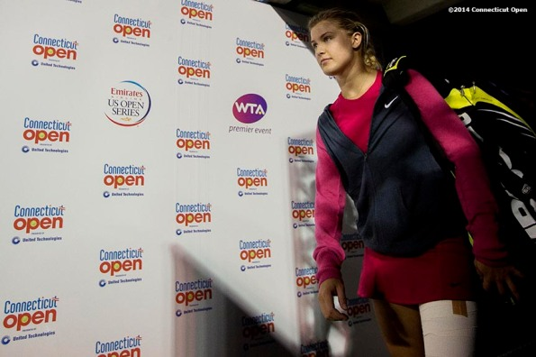 """""""Eugenie Bouchard walks through the tunnel onto stadium court before a match against Samantha Stosur on day six of the 2014 Connecticut Open at the Yale University Tennis Center in New Haven, Connecticut Tuesday, August 20, 2014."""""""