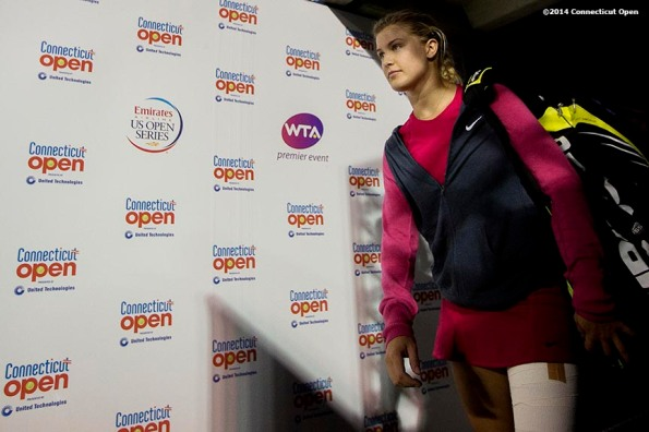 """Eugenie Bouchard walks through the tunnel onto stadium court before a match against Samantha Stosur on day six of the 2014 Connecticut Open at the Yale University Tennis Center in New Haven, Connecticut Tuesday, August 20, 2014."""