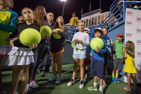 """""""Fans wait for autographs after a match on stadium court on day six of the 2014 Connecticut Open at the Yale University Tennis Center in New Haven, Connecticut Tuesday, August 20, 2014."""""""