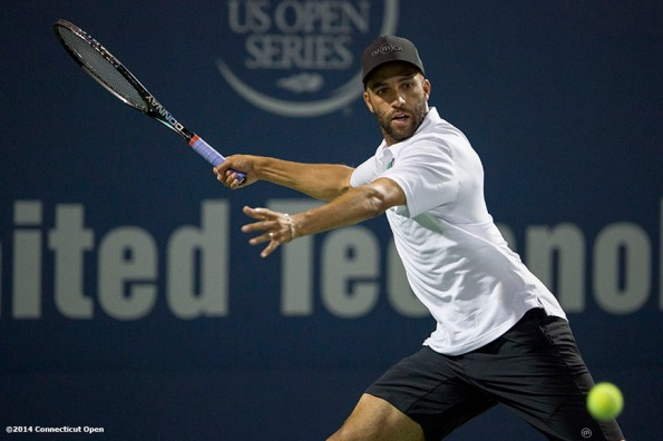 """James Blake hits a forehand during the Men's Legends Event on day six of the 2014 Connecticut Open at the Yale University Tennis Center in New Haven, Connecticut Wednesday, August 20, 2014."""