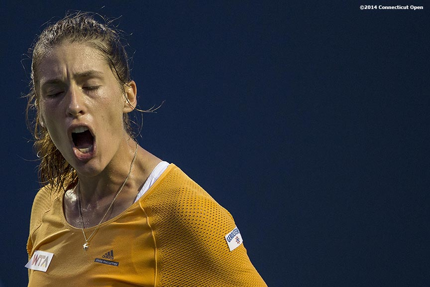 """Andrea Petkovic reacts during a match against Kirsten Flipkens on day six of the 2014 Connecticut Open at the Yale University Tennis Center in New Haven, Connecticut Tuesday, August 19, 2014."""