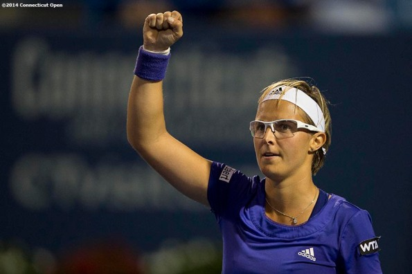 """""""Kirsten Flipkens reacts after defeating Andrea Petkovic on day six of the 2014 Connecticut Open at the Yale University Tennis Center in New Haven, Connecticut Tuesday, August 19, 2014."""""""