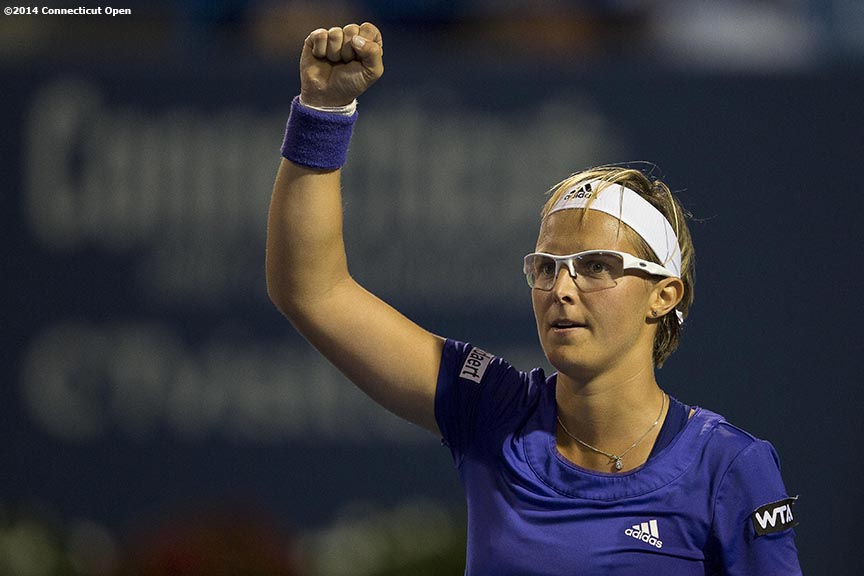 """Kirsten Flipkens reacts after defeating Andrea Petkovic on day six of the 2014 Connecticut Open at the Yale University Tennis Center in New Haven, Connecticut Tuesday, August 19, 2014."""