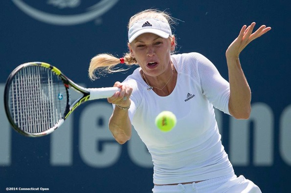 """Caroline Wozniacki hits a forehand during a match against Camila Giorgi on day six of the 2014 Connecticut Open at the Yale University Tennis Center in New Haven, Connecticut Tuesday, August 19, 2014."""