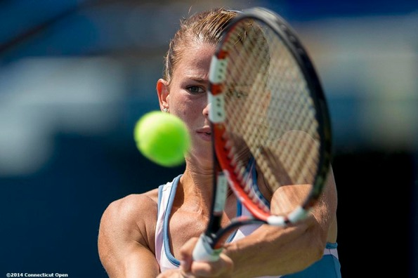 """""""Camila Giorgi hits a backhand during a match against Caroline Wozniacki on day six of the 2014 Connecticut Open at the Yale University Tennis Center in New Haven, Connecticut Tuesday, August 19, 2014."""""""