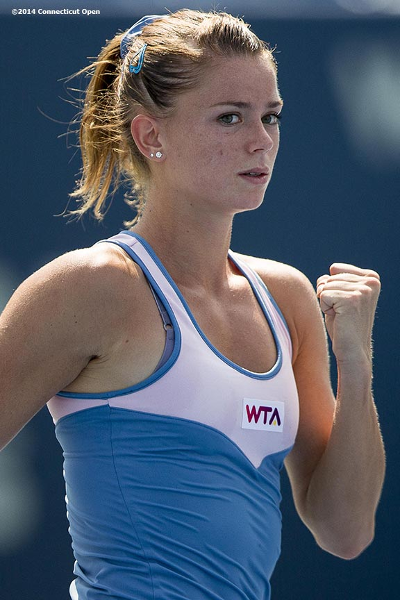 """""""Camila Giorgi reacts after defeating Caroline Wozniacki on day six of the 2014 Connecticut Open at the Yale University Tennis Center in New Haven, Connecticut Tuesday, August 19, 2014."""""""