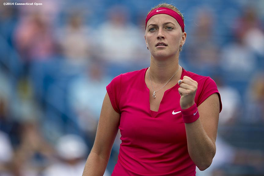 """Petra Kvitova reacts during a match against Barbora Zahlavova Strycova on day seven of the 2014 Connecticut Open at the Yale University Tennis Center in New Haven, Connecticut Thursday, August 21, 2014."""