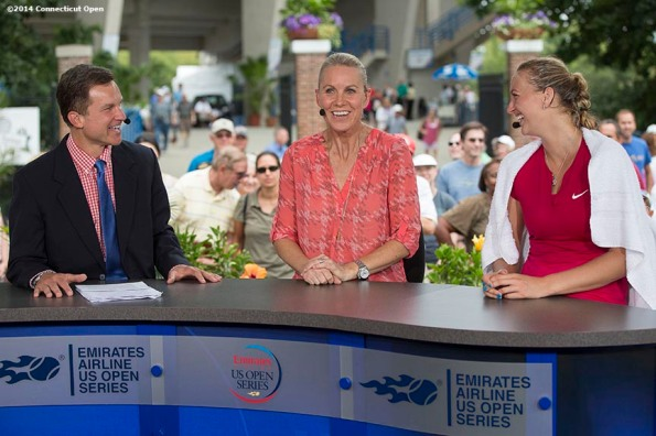 """Petra Kvitova appears on the ESPN television set alongside hosts Sam Gore and Renee Stubbs after defeating Barbora Zahlavova Strycova on day seven of the 2014 Connecticut Open at the Yale University Tennis Center in New Haven, Connecticut Thursday, August 21, 2014."""