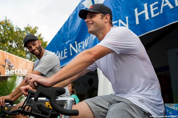 """""""James Blake and Andy Roddick ride spin bikes for Yale New Haven Health during the Men's Legends Event on day seven of the 2014 Connecticut Open at the Yale University Tennis Center in New Haven, Connecticut Thursday, August 21, 2014."""""""