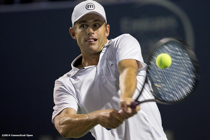 """Andy Roddick hits a backhand during the Men's Legends Event on day seven of the 2014 Connecticut Open at the Yale University Tennis Center in New Haven, Connecticut Thursday, August 21, 2014."""