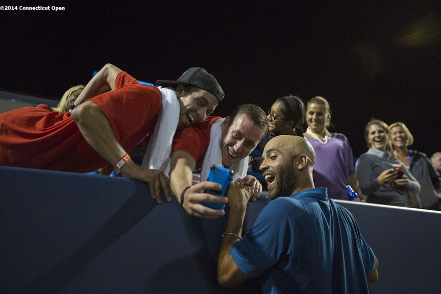 """James Blake poses for a selfie photograph with fans during the Men's Legends Event on day seven of the 2014 Connecticut Open at the Yale University Tennis Center in New Haven, Connecticut Thursday, August 21, 2014."""